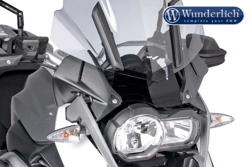 Deflector de viento para elementos de mando